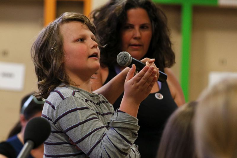 TRIBUNE FILE PHOTO - Tamara Rubin's son Avi testifies at a Portland Public Schools town hall meeting in June on lead discoveries in the school water while she looks on.