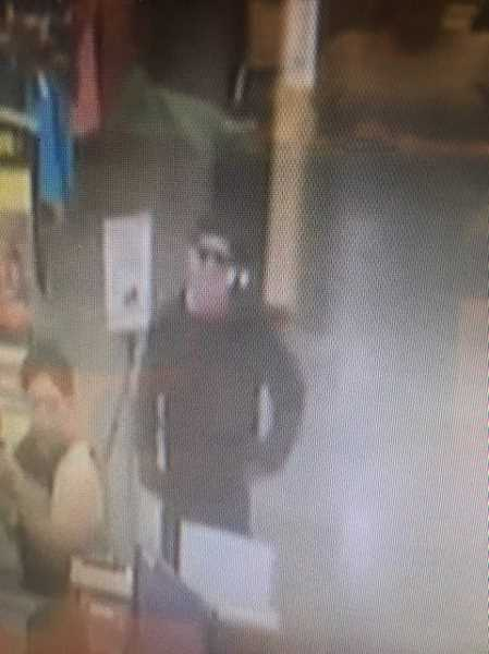 SUBMITTED PHOTO - Another surveillance photo of the Fred Meyer robbery suspect.