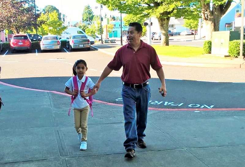 NEWS-TIMES PHOTOS: STEPHANIE HAUGEN - Sarai Ascension and her father walk to Cornelius Elementary School Monday, Aug. 29, for the first day of the 2016-17 school year. Sarai is starting first grade in Angie Carver's class.