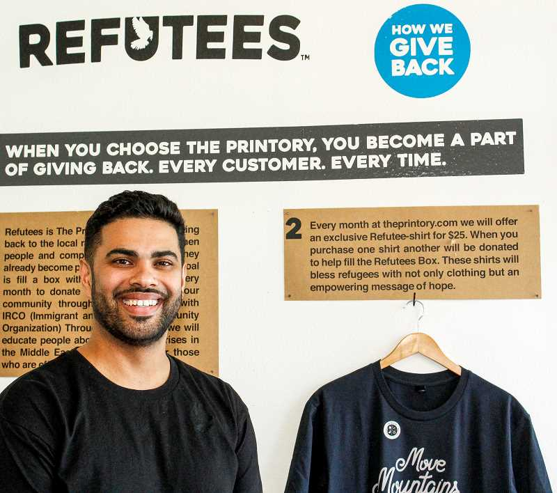 HILLSBORO TRIBUNE PHOTO: TRAVIS LOOSE - Hussein Al-Baiaty of Hillsboro launched a program earlier this year to work with local refugees. The company provides T-shirts to refugee families for job interviews.