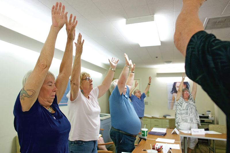TRIBUNE PHOTO: JAIME VALDEZ - Students in a Kaiser Permanente pain management class participate in a movement exercise to aid their chronic pain.