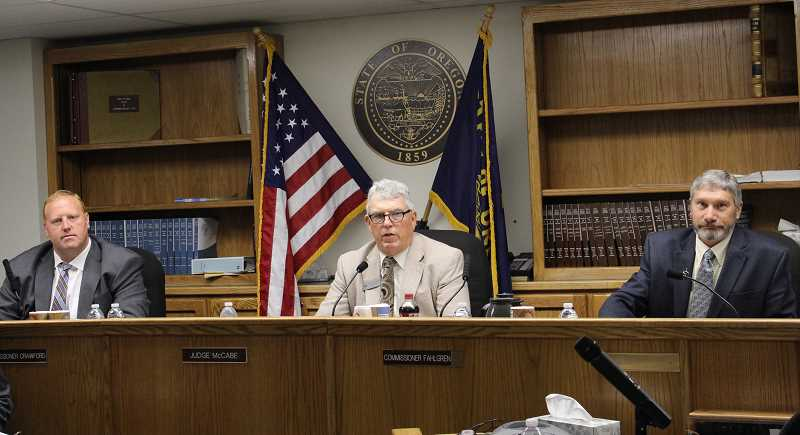 JASON CHANEY - The Crook County Court takes testimony during Tuesday's meeting.