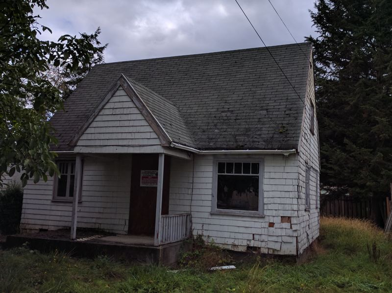 SPOTLIGHT PHOTO: COURTNEY VAUGHN - A house on 10th Street in St. Helens has sat vacant for at least the last six years. It needs repairs, but with a little work, it and one other property could be the latest boon for an affordable housing program.