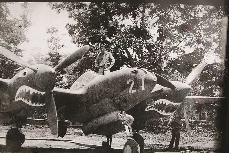 COURTESY PHOTOS - Lt. Mangas stands on his favorite P-38, No. 27. Mangas scored two confirmed victories over Japanese fighters and several more probable kills.