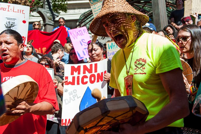 TRIBUNE PHOTO: DIEGO G. DIAZ - Members of several tribes, including the Nisqualy of the Confederated Tribes of the Chehalis Reservation, drummed and chanted during Friday afternoon's gathering to support the Standing Rock Sioux Nation protest in North Dakota.