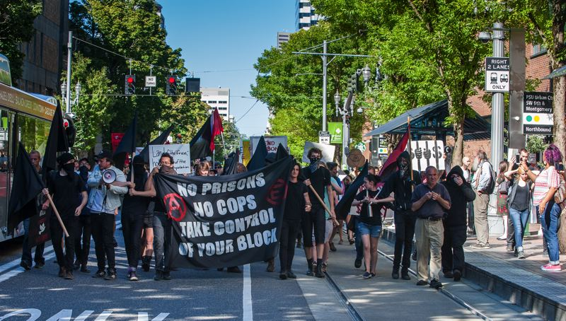 TRIBUNE PHOTO: DIEGO G. DIAZ - Dozens of people marched through downtown Portland Friday, Sept. 9, to protest prison labor. Two people were arrested in the protest.