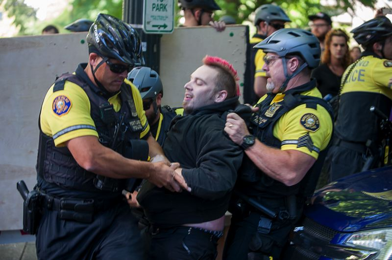 TRIBUNE PHOTO: DIEGO G. DIAZ - A man was arrested Friday, Sept. 9, during a protest in downtown Portland focusing on prison labor.