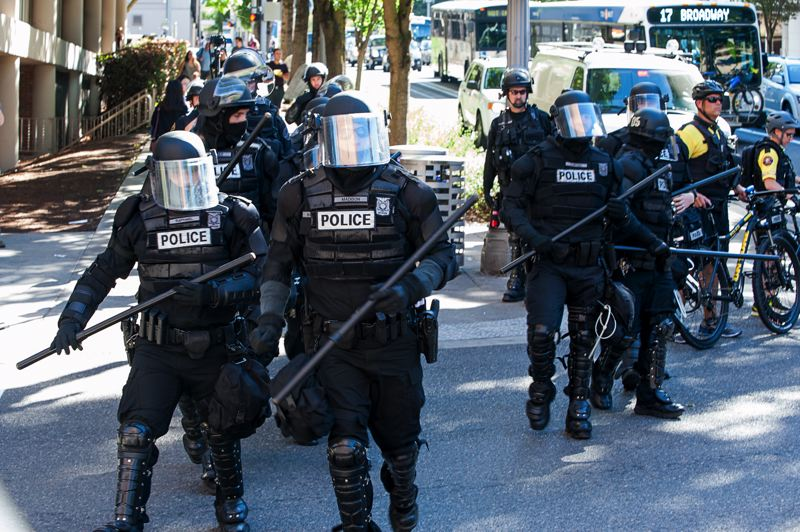 TRIBUNE PHOTO: DIEGO G. DIAZ - Portland police in riot gear confronted protesters near the Downtown Justice Center Friday afternoon, Sept. 9.