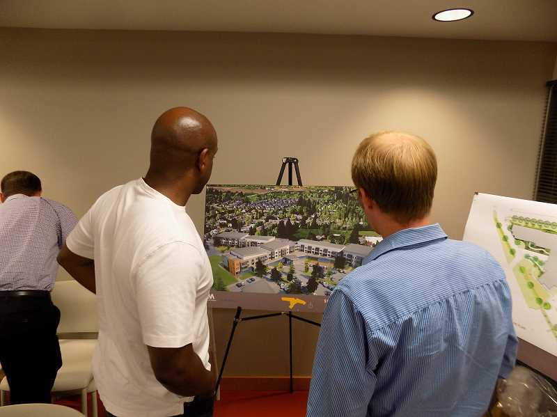 GAZETTE PHOTO: RAY PITZ - A Sherwood resident takes a look at a proposed 135-unit, three-story assisted living facility planned for the city during a Sept. 12 meeting at the Sherwood Center for the Arts.