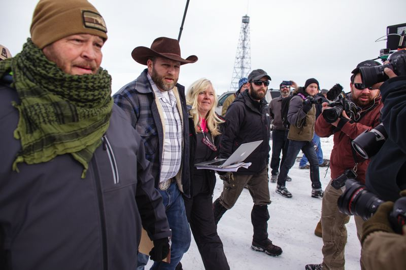 TRIBUNE FILE PHOTO: ROB KERR - Ammon Bundy, center, faces trial beginning this week on charges surrounding the January takeover of the Malheur National Wildlife Refuge near Burns. A judge ruled Monday that Facebook posts could be used as evidence in the trial.