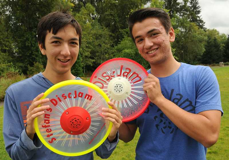 REVIEW PHOTO: VERN UYETAKE - Stefan Seiji Dassise (left), a junior at Lake Oswego High, and Lakeridge High School graduate Alex Dassise hold a new product, the DiscJam.