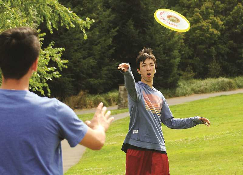 REVIEW PHOTO: VERN UYETAKE - Stefan Seiji Dassise tosses the DiscJam with his brother on a perfect August day.