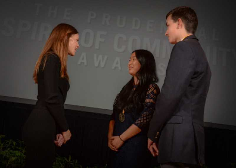 SUBMITTED PHOTO: ZACH HARRISON PHOTOGRAPHY - Academy Award-winning actress Hilary Swank congratulates Lincoln High School student Alisha Zhao and Lake Oswego Junior High eighth-grader Michael Murray in May for being named Oregon's top two youth volunteers for 2016. The ceremony was held at the Smithsonian's National Museum of Natural History in Washington, D.C.