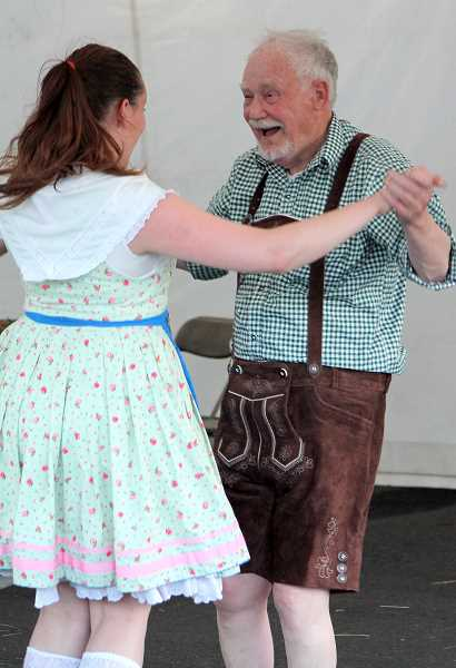TIDINGS PHOTO: LESLIE PUGMIRE HOLE - Alpine Echoes musician Vic Hatch performs a tradional folk dance with Madeline Baumann.