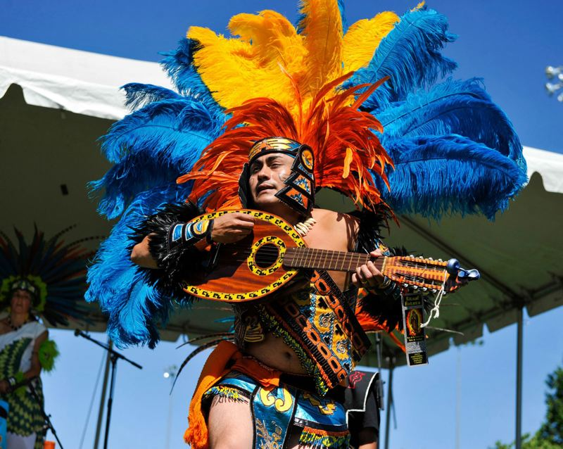 TIMES FILE PHOTO - A member of the Ritual Azteca Huitzilopochtli dance group performs during the 2016 Party in the Park at the Howard M. Terpenning Recreation Center in Beaverton.
