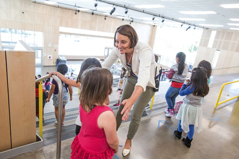 TIMES PHOTO: JONATHAN HOUSE - Vose Elementary assistant principal Melissa Holz helps students to the cafeteria during lunch time.