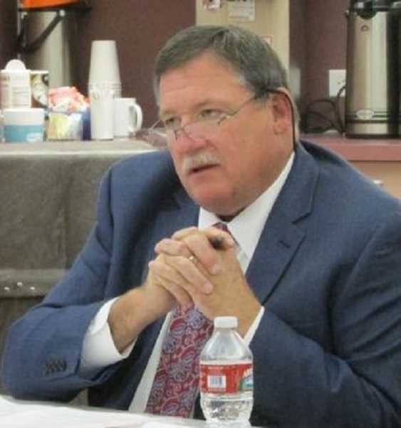 SPOTLIGHT FILE PHOTO - Kevin Owens, former general manager of Columbia River PUD, will pay $5,000 in a settlement agreement with the utility district. Owens filed suit against his former employer in September 2015 alleging breach of contract for disparaging statements made during a board meeting.
