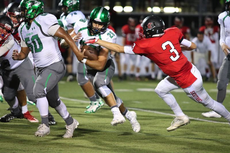 THE OUTLOOK: JIM BESEDA - Reynolds running back Anthony Pelster looks for a seam during Fridays 43-20 loss at Clackamas.