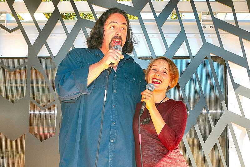 DAVID F. ASHTON - Opera a la Carte singers baritone Erik Hundtoft and soprano Catherine Olson perform their duet, Papageno/Papagena, from Mozarts Magic Flute, for the students and parents of Holgate Boulevards Tucker-Maxon School on September 9th.