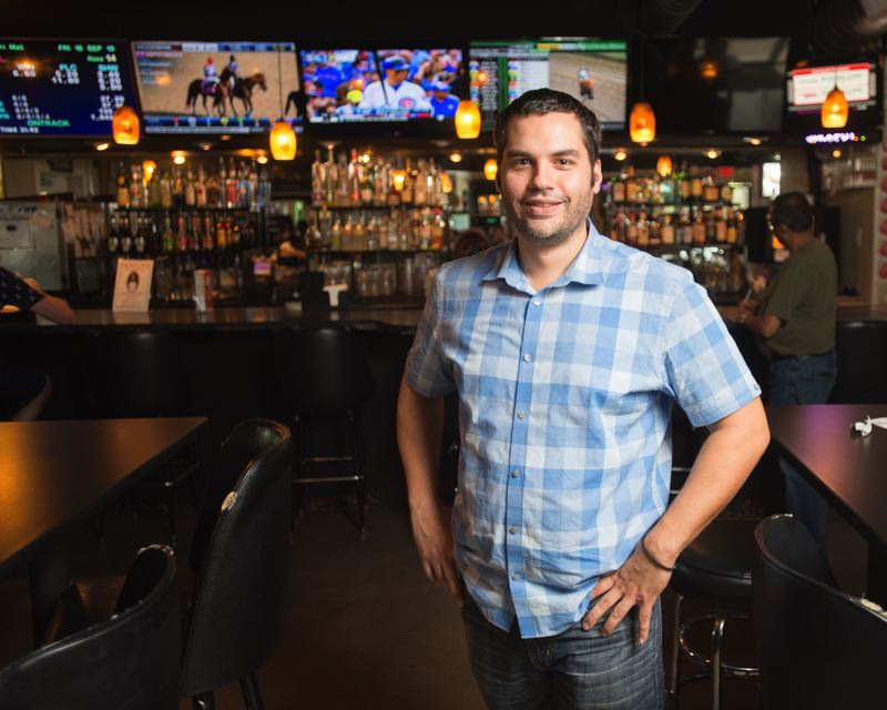 OUTLOOK PHOTO: JOSH KULLA - Anestis Polizos, owner of Alexander's Off Track Betting Sports Bar, hopes a Grand Ronde development won't draw too many customers away from his businesses.