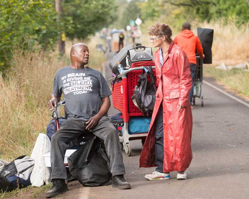 OUTLOOK PHOTO: JOSH KULLA - Homeless campers gather on the Springwater Corridor Trail Sept. 1, the first day of an ongoing city of Portland cleanup of homeless camps along the popular hiking and biking trail. With hundreds of campers on the move, there appears to be little way of tracking where those persons have gone.