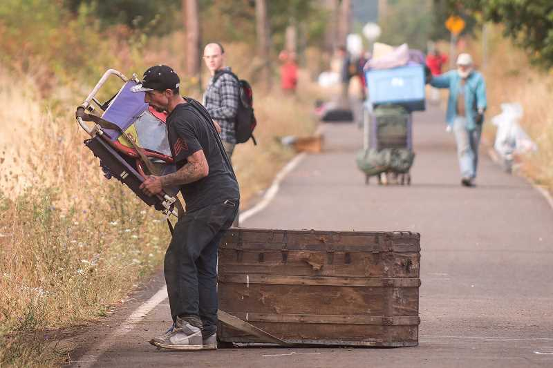OUTLOOK PHOTO: JOSH KULLA - Homeless campers on the move Sept. 1 on the Springwater Corridor Trail in Southeast Portland.