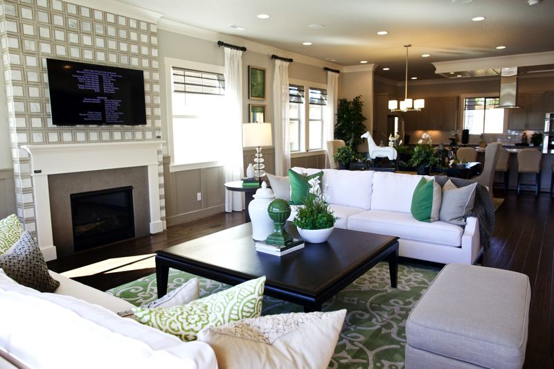 TIMES PHOTO: JAIME VALDEZ - A peek inside a model home shows an open floor plan with a living and dining room, as well as a kitchen, at the River Terrace development off Southwest 150th Avenue.
