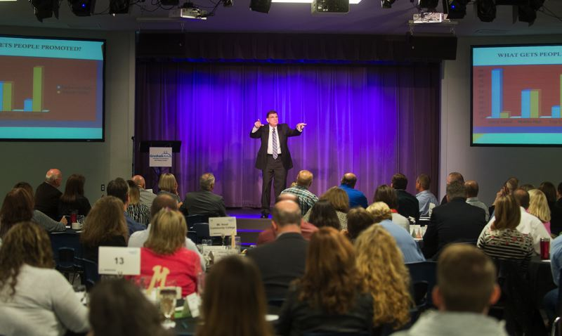 OUTLOOK PHOTO: JOSH KULLA - Mike Hourigan discusses how to better engage members of the Millennial generation in the workplace Wednesday at the Gresham Area Chamber of Commerce's Economic Summit.