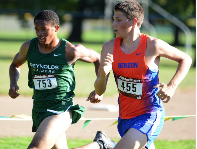 THE OUTLOOK: DAVID BALL - Reynolds Andre Abel surges past Bensons Toby Mick on his way to the finish line as the Raiders No. 5 runner Wednesday at Westmoreland Park.