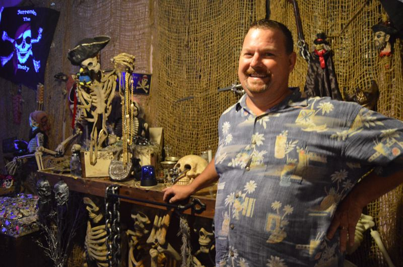 SPOTLIGHT PHOTO: NICOLE THILL - Chris Aarseth stands in the pirate room of the haunted house, which has been decorated by his fiancé, Cheryl Lyn Malloneé, on Tuesday, Sept. 27. Opening night for the haunted house is Friday, Sept. 30.
