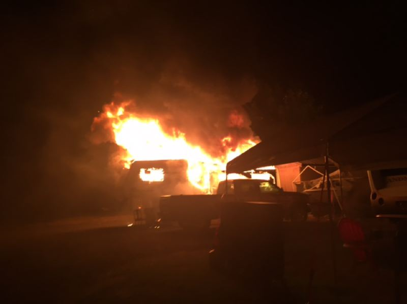 PHOTO COURTESY OF TROY HANNEMANN - A photo of the fire inside a fifth-wheel trailer of a Deer Island couple Wednesday night. The blaze quickly spread to several nearby parked cars, a shed and a boat.