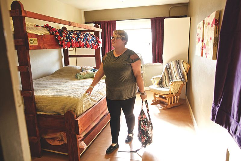 PORTLAND TRIBUNE: JAIME VALDEZ - Lindsey, who lived for a short-time at Community of Hope homeless shelter with her son in 2015, looks at the remodeled room where she stayed that is named, Mercy. The homeless shelter in St. Johns reopened recently after a remodel that included new shower rooms.