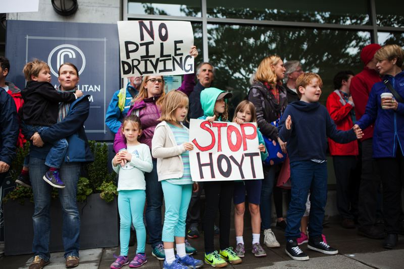 PHOTO FOR THE TRIBUNE: ADAM WICKHAM - Organizers of a Sunday protest in front of Hoyt Street Properties said they are frustrated that the company is moving forward on plans to use noisy impact pile driving to build a new skyscraper near a kindergarten and housing.