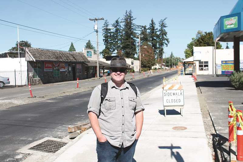 CONNER WILLIAMS / MOLALLA PIONEER  - Nathan Klein, a Molalla citizen, stopped to discuss his views on the construction