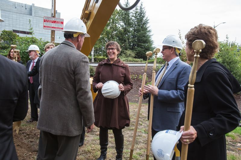 JONATHAN HOUSE - Multnomah County Commissioner Judy Shiprack chats at the groundbreaking for the new courthouse.