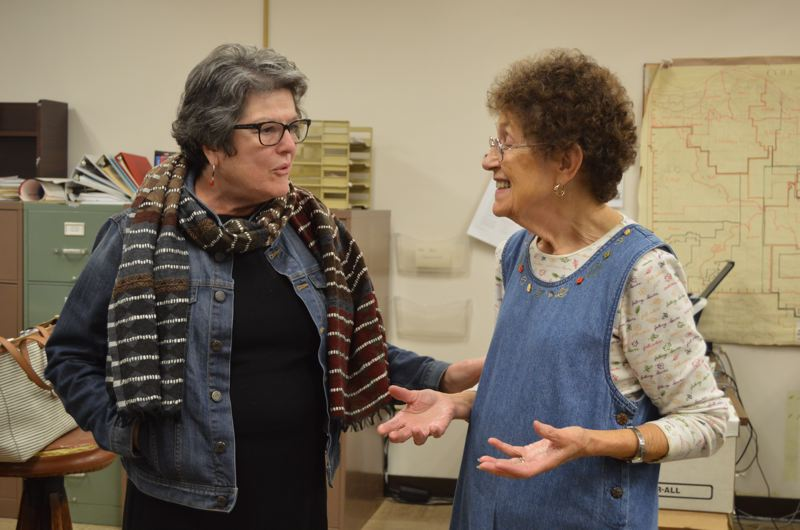 SPOTLIGHT PHOTO: NICOLE THILL - Secretary of State Jeanne Atkins and Columbia County Clerk Betty Huser chat together in the courthouse on Thursday, Oct. 6. Huser took Atkins on a brief tour of the clerk's office where ballots are collected and counted during elections.