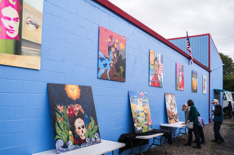 HILLSBORO TRIBUNE PHOTO: CHASE ALLGOOD - A crowd gathers to view the paintings at the unveiling celebration of The Frida Project Saturday.