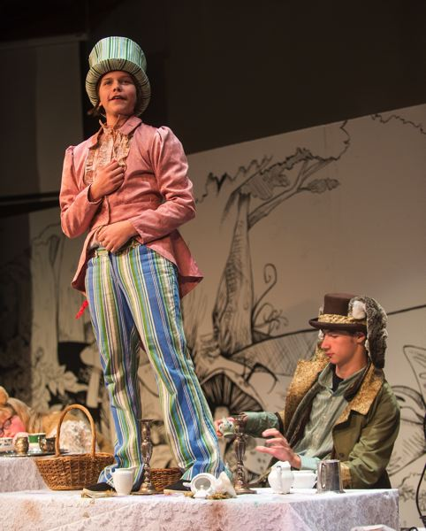 OUTLOOK PHOTO - Simeon Johnson is the Mad Hatter and Alex Turner is the March Hare in the Corbett Children's Theater production of 'Alice in Wonderland.'
