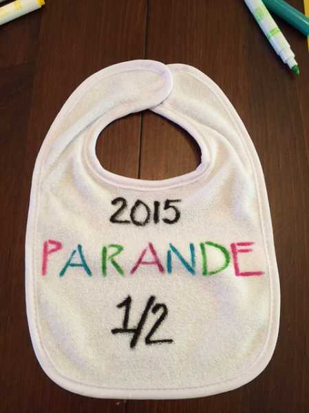 SUBMITTED PHOTO - Cheri Partain and Julie Strande pinned baby bibs on shirts to identify runners in the 2015 Parande. They use real race bibs now.