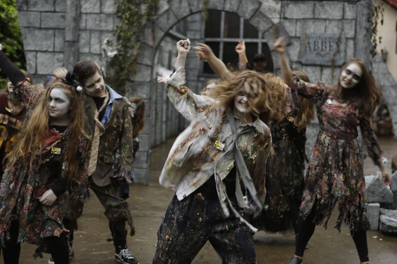 PHOTO BY: ALVARO FONTAN - Members of Independent Dance Project do a zombie dance at Davis Graveyard.