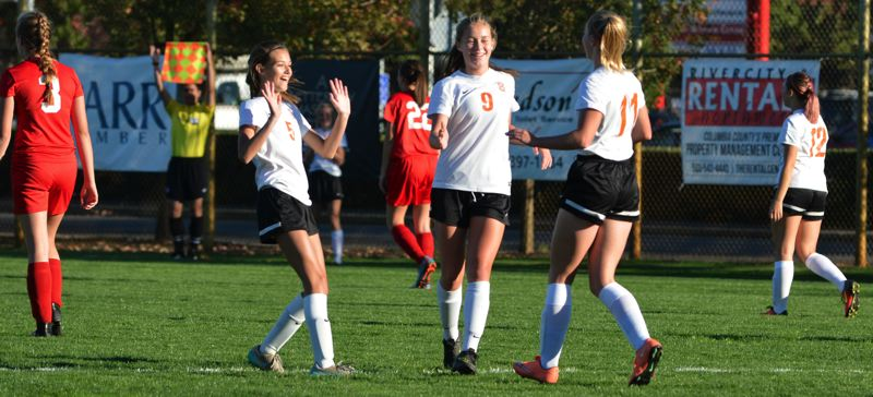 SPOTLIGHT PHOTO: JAKE MCNEAL - Lauren Whisenhunt (5), Faith Woodall (9) and Nicole Nicholas (11) celebrate one of 14 goals against Tillamook on Tuesday at Scappoose Middle School's Chinook Field.