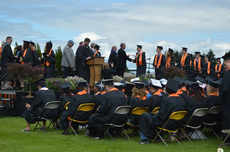 SPOTLIGHT FILE PHOTO - Graduation rates in the Scappoose and St. Helens school districts declined in the 2014-15 school year, according to state data released this week. Data about each high school can be found in the Oregon Department of Education report cards online.