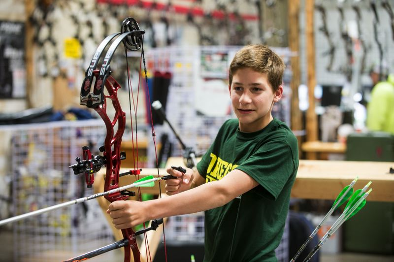 OUTLOOK PHOTO: JOSH KULLA - Ingram, with his high-tech bow, readies a shot at the practice range at Archery World in Troutdale.