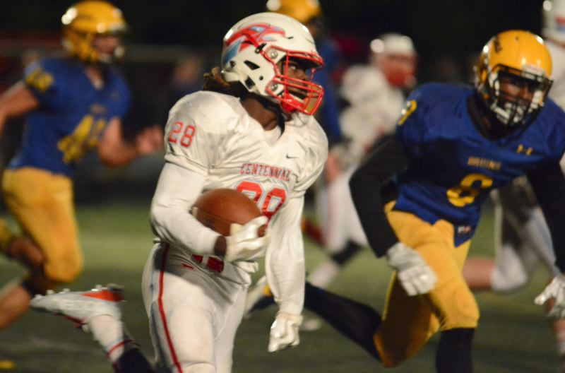 THE OUTLOOK: DAVID BALL - Centennial running back Jesse Porter gets loose around the edge for a big gain.