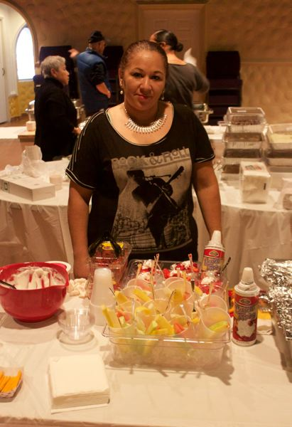 OUTLOOK PHOTO - Cecilia Negret served rainbow fruit during the walk, talk, eat event. She hopes to open a small business serving dessert fruits.