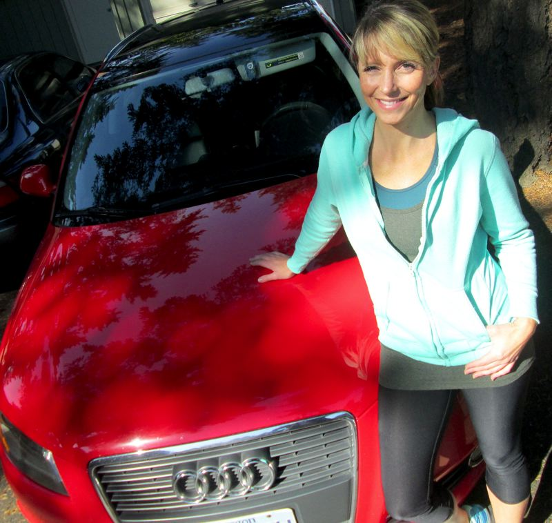 TRIBUNE PHOTO: KEVIN HARDEN - Cassandra Ulven, public information officer for Tualatin Valley Fire & Rescue, loves her 2010 Audi A3 diesel sportback. So she was disappointed when the car's 'clean' emissions system turned out to be the result of a defeat device. She and her husband are not sure what they are going to do with their two diesel vehicles.
