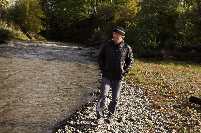 TRIBUNE PHOTO: JAIME VALDEZ - Travis Williams, head of the WIllamette Riverkeeper, walks along Johnson Creek before its confluence with the Willamette River in Milwaukie.