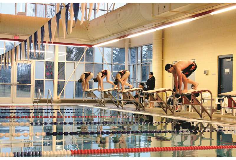 PIONEER FILE PHOTO - The Molalla High School swim team, shown at practice, above, in 2014, will be able to dive back into their hometown pool after being locked out for two seasons following the city's closure of Molalla's aquatic center. The school district is now reopening the center for use by the MHS swim team and some elementary school swim lessons.