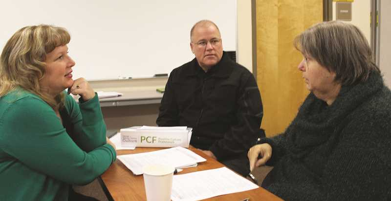 PEGGY SAVAGE - From Left: Kirsten Ingersoll, Molalla Police Sgt. Frank Schoenfeld and Lynn Blatter share opinions in a small group discussion during last week's workshop, held at the Molalla Fire Station.