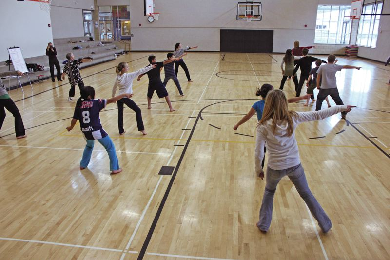 COURTESY RIGHT BRAIN INITIATIVE - Sixth graders at Quatama Elementary in Hillsboro worked with Oregon Ballet Theatre through The Right Brain Initiative to demonstrate their understanding of the water cycle with movement.